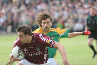 Colin Regan for Leitrim pays close attention to Galway ace forward Nicky Joyce, in the 2007 Championship at Paric Sean. Photo by James Molloy.