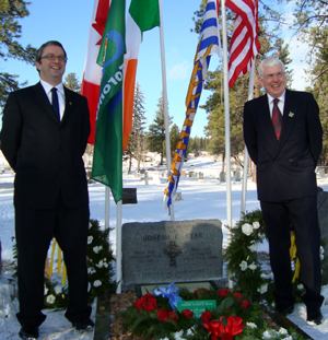 Secretary John O'Flynn (left) and Chairman Brian Farmer of Canada GAA at the grave of one of the founders of the GAA, Joseph P. Ryan,  who is buried in Cranbrook, British Columbia CANADA during the 125th Anniversary Celebrations, December 19, 2009.